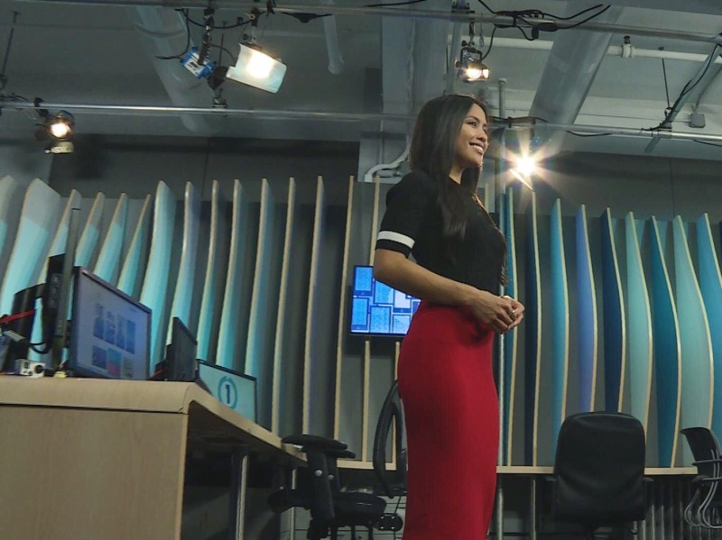 Azia Celestino from Channel One News in a red pencil skirt