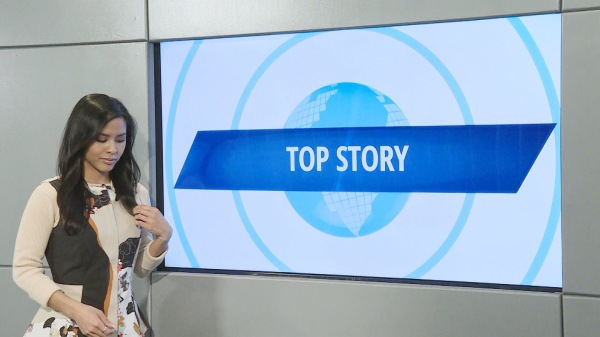Azia Celestino reports in the daily show at Channel One News