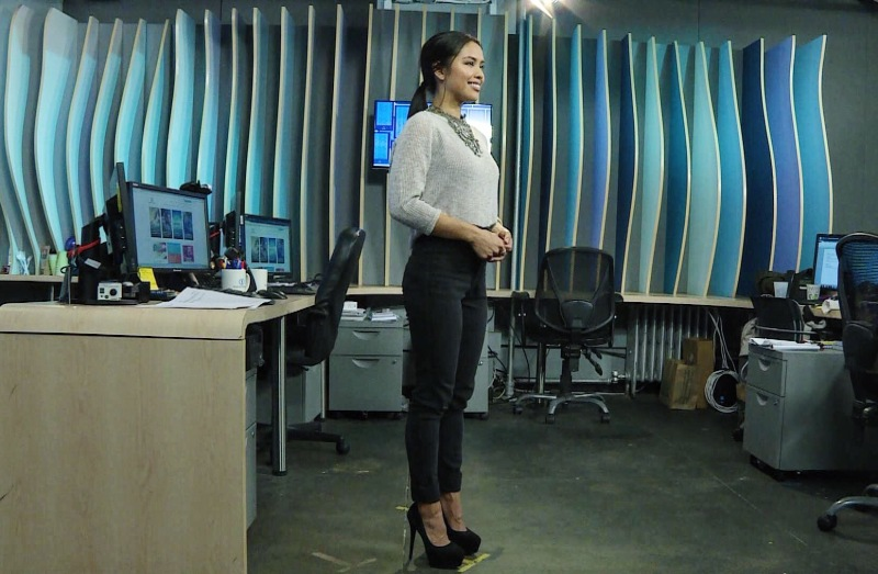 Azia Celestino anchors Channel One News in a sleek outfit